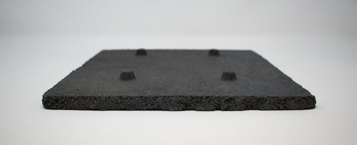 Underside of a hearth plate to show the four standoffs that stick up from its surface